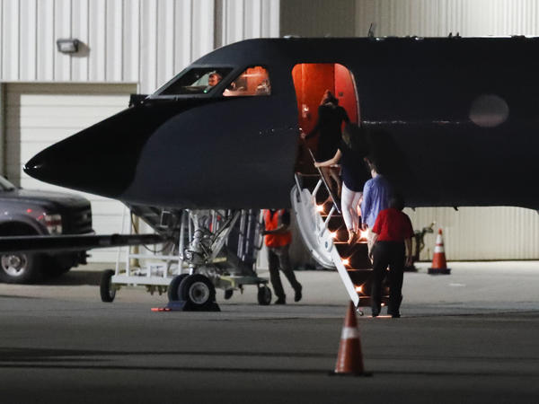 Visitors and medical personnel enter a transport plane carrying Otto Warmbier at a Cincinnati regional airport Tuesday. Warmbier, who was released and medically evacuated from North Korea, has been in a coma for months, his parents said.