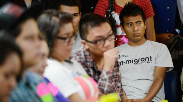 """Immigrants who were brought to the U.S. illegally as children, known as """"Dreamers,"""" listen to the kick off of the Obama administration's Deferred Action for Childhood Arrivals program in 2012."""