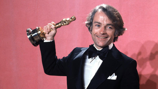 John Avildsen shows off the best director Oscar he won in 1977 for <em>Rocky</em>. Avildsen, who also directed <em>The Karate Kid</em>, died Friday from pancreatic cancer at age 81 in Los Angeles.