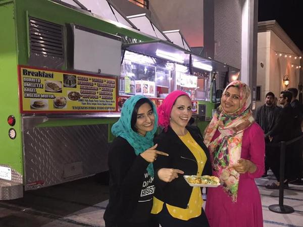 Rida Hamida (center), one of the organizers of Taco Trucks At Every Mosque, at an event at the Islamic Society of Orange County. (Courtesy)