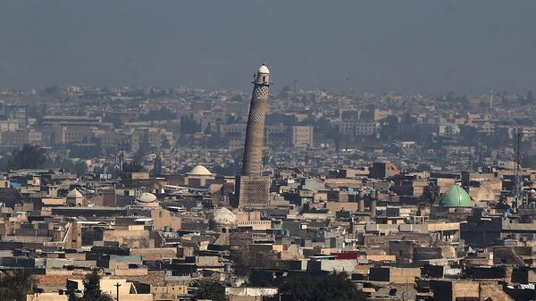 """The Great Mosque of al-Nuri in Mosul, with its tall, leaning al-Hadba minaret, was where ISIS leader Abu Bakr al-Baghdadi declared the group's """"caliphate"""" in Iraq and Syria in July 2014."""