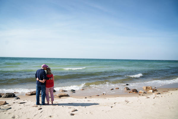 Greg and Mary Catherine walk to the beach in Brewster, Mass., where they live.
