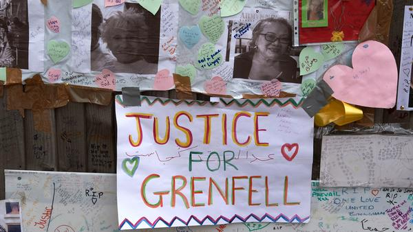 Tributes to victims of the Grenfell Tower fire are left near the building in West London on Friday. Combustible cladding has been found in a number of similar tower blocks in Britain, Prime Minister Theresa May said.