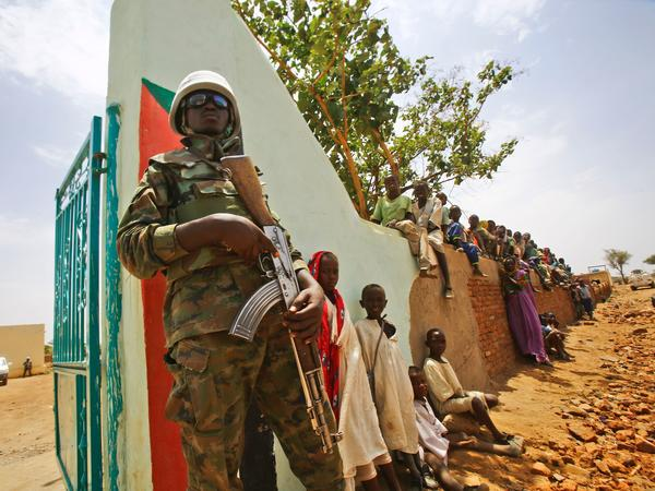 A U.N. peacekeeper stands guard in central Darfur on June 19. The town, a former rebel bastion, was recently captured by Sudanese government forces. The top U.S. diplomat in Sudan, Steven Koutsis, visited Darfur last month to assess security before the Trump administration decides whether to lift sanctions.