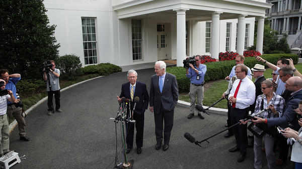 Senate Majority Leader Mitch McConnell, R-K.Y. (left), and Senate Majority Whip John Cornyn, R-Texas, speak to members of the media outside the West Wing of the White House on Tuesday in Washington, D.C.