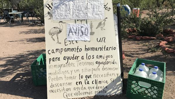 A sign outside the camp warns migrants that operations are closed for now.