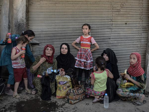 Iraqis fled the Old City of Mosul on June 23 after escaping the fighting between Iraqi forces and Islamic State jihadists.