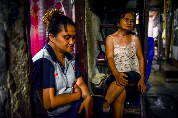Marcelina Mallari (right) and her daughter Gina share the heartache of losing Robert, Mallari's son and Gina's brother, in the drug war.