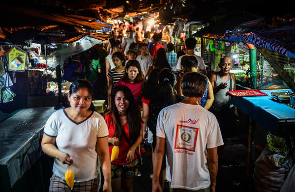 Shoppers stroll in a night market in Manila's Arellano neighborhood.