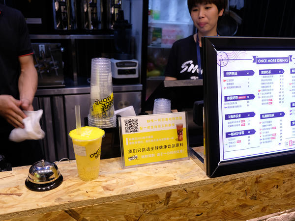 A juice shop in east Hangzhou displays a QR code next to the menu, allowing customers to pay with mobile payment apps on their smartphones.