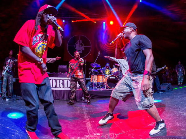 Flavor Flav, Professor Griff and Chuck D of Public Enemy perform at Freedom Hill Amphitheater on August 6, 2016 in Sterling Heights, Michigan.