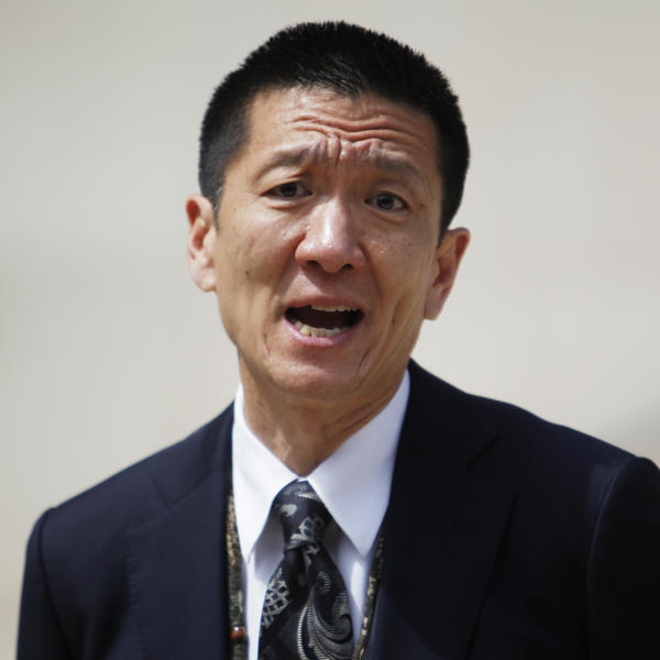 Hawaii Attorney General Douglas Chin speaks at a news conference in Honolulu in March. His office has asked a federal court to review the Trump administration's definition of close family, in the context of the travel ban.