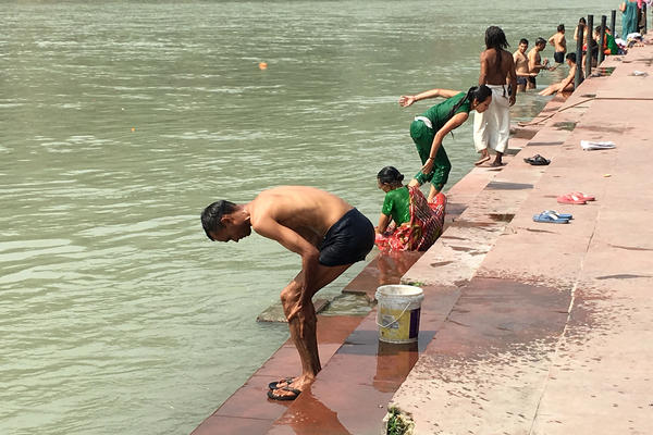 A man bathes on the banks of the Ganges River in the town of Rishikesh near the headwaters. Up and down the 1,500-mile course of the iconic river, Indians worship, wash, and cremate their dead — a practice that environmentalists say pollutes the river and should be curtailed.