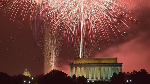 Fireworks explode over the Lincoln Memorial, the Washington Monument and the U.S. Capitol on July 4, 2015.
