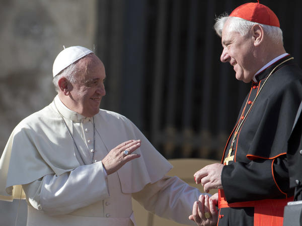Pope Francis talks with Cardinal Gerhard Ludwig Mueller in St. Peter's Square at the Vatican on Wednesday, Nov. 19, 2014.