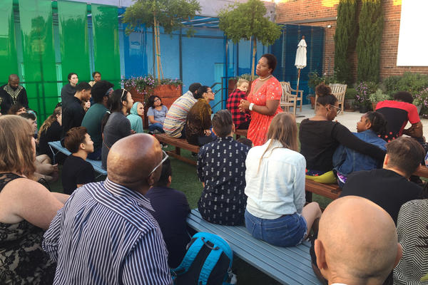 Patrisse Khan-Cullors, a co-founder of the Black Lives Matter Network, leads a gathering at The Underground Museum in Los Angeles in memory of Charleena Lyles and other police shooting victims.