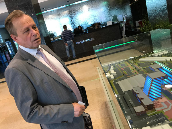 Vladimir Nikonov, the director of Academpark, stands in front of a model of the technology park.