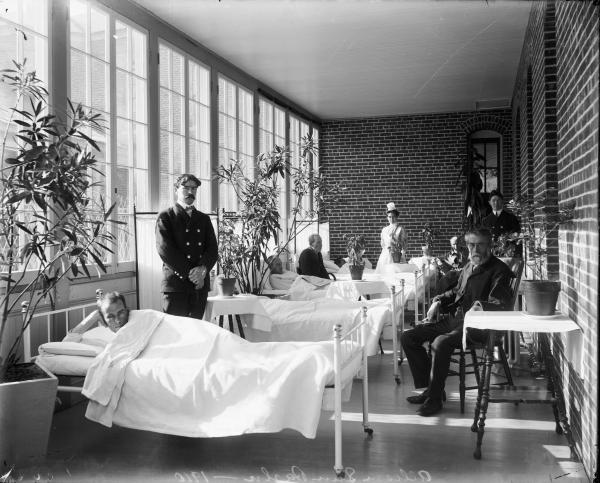 The porches of the 1890s Allison Buildings, shown above in 1910, were later enclosed to provide more space for patient beds.