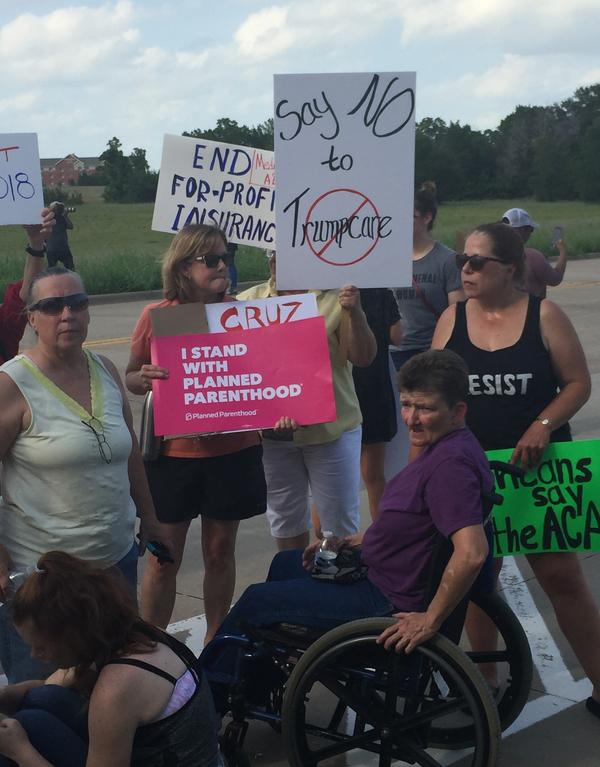"""One protester held a sign reading """"Say NO to Trumpcare,"""" in opposition to the Senate's effort to repeal the Affordable Care Act."""