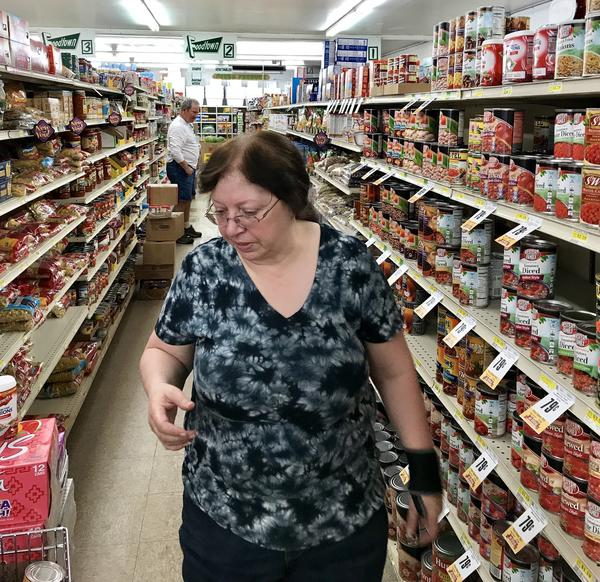 Volunteers helped clean up the mess at D&D Foodtown grocery, after an earthquake hit overnight. Assistant manager Ruth Baker says the damage included pickle jars and wine bottles.