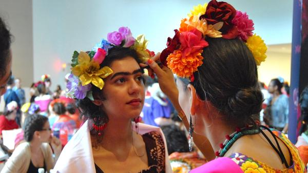 Elisa Saldivar gets a Frida Kahlo-inspired look, courtesy of Reina Rebelde. The makeup line was helping participants in the record attempt get ready before the final tally.