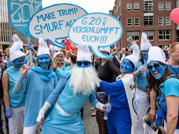 "Pro-Smurf demonstrators are seen at Saturday's ""Grenzenlose Solidaritaet"" (""unlimited solidarity"") protest march in Hamburg, Germany."