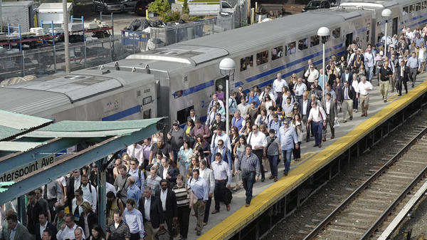 Long Island Rail Road commuters arrive at the Hunterspoint Avenue station in Queens on Monday morning to transfer trains.