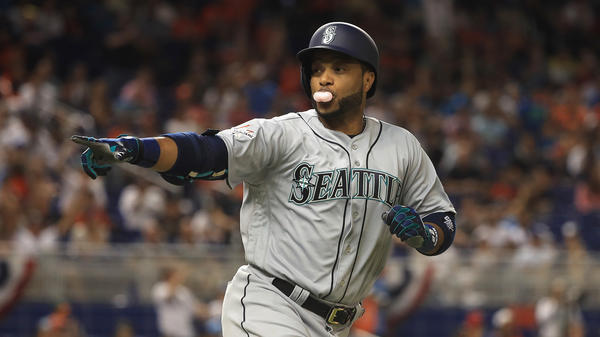 Robinson Cano of the Seattle Mariners blows a bubble as he rounds the bases after hitting a home run in the tenth inning of Tuesday's MLB All-Star Game in Miami. It would be the winning run for the American League.