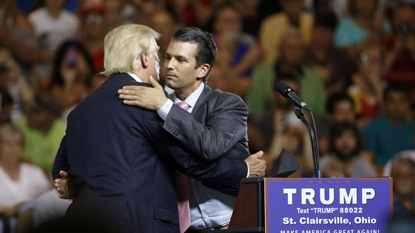 Donald Trump Jr. hugs his father, Donald Trump, during a campaign rally in Ohio, weeks after Trump Jr. met with a Russian lawyer, as he sought dirt against Democrat Hillary Clinton.