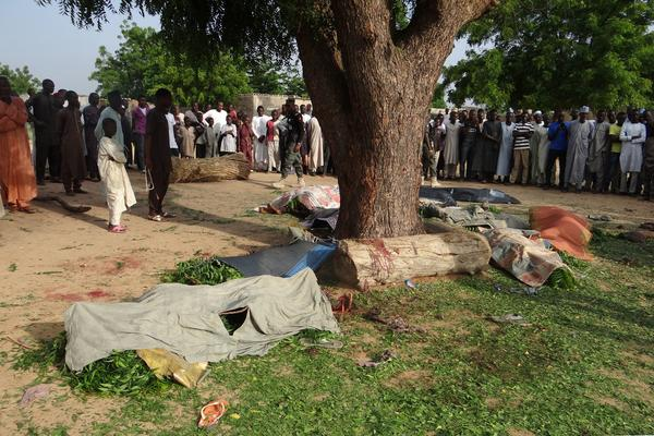 People gather on Wednesday to view the bodies of victims of a suicide bombing attack Tuesday night in Maiduguri, Nigeria.