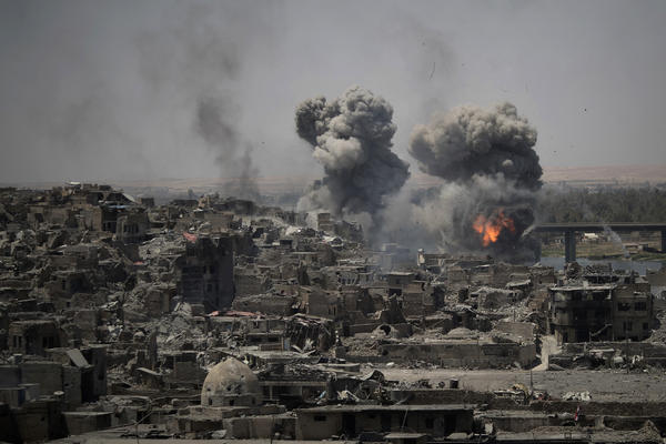 "Airstrikes target Islamic State positions on the edge of the Old City on Tuesday, a day after Iraq's prime minister declared ""total victory"" in Mosul, Iraq."