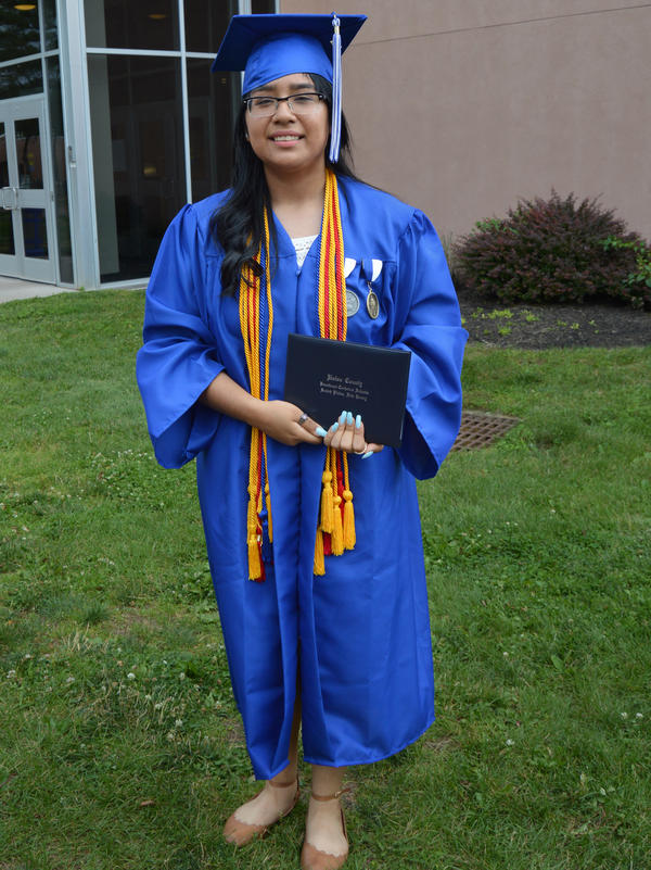 Desiree Armas graduated in June from Union County Magnet High School in New Jersey wearing medals and honor cords that represent her academic and extracurricular accomplishments.