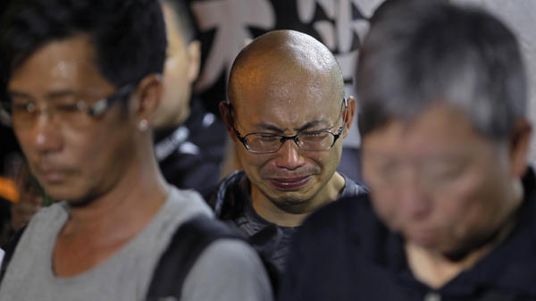 A protester cries as he mourns jailed Chinese Nobel Peace laureate Liu Xiaobo during a demonstration outside the Chinese liaison office in Hong Kong on Thursday. Officials say China's most prominent political prisoner, Nobel Peace Prize laureate Liu Xiaobo, has died at 61.