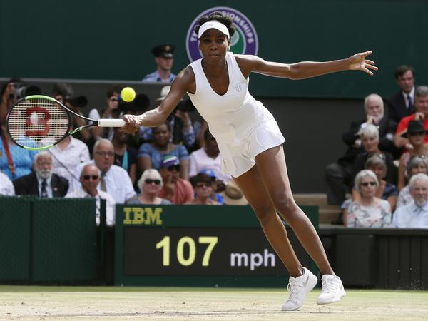 Venus Williams returns to Britain's Johanna Konta during her victory in a semifinal match at the Wimbledon Tennis Championships in London on Thursday.