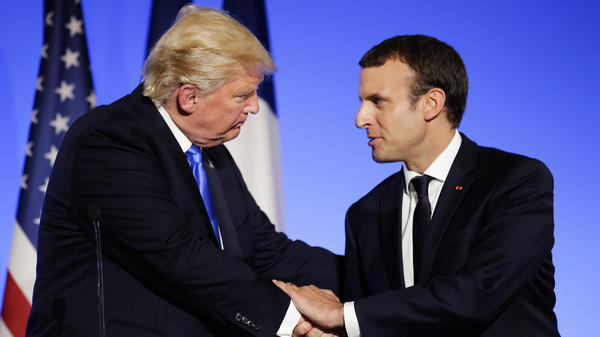 President Trump has joined French President Emmanuel Macron in Paris to celebrate Bastille Day.