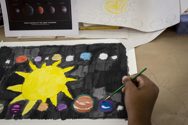 "Artist Imani Turner works on a watercolor piece inspired by the solar system. ""Art creates opportunities for all of us to learn about ourselves,"" says Tony Brunswick, the executive director of Art Enables. ""We really believe in the power of art."""