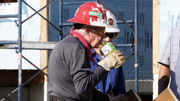 "Former President Jimmy Carter, on site building homes for Habitat for Humanity in Winnipeg, Canada, on Thursday. Carter was treated for dehydration, but now says ""he is okay,"" according to Habitat for Humanity CEO Jonathan Reckford."