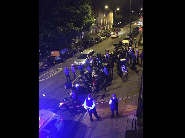 Authorities respond to the scene of an acid attack in London on Thursday night.