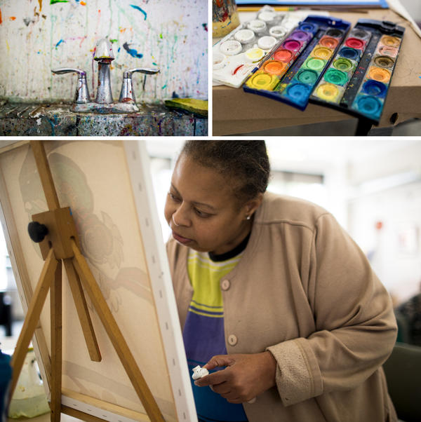 "A paint-splattered sink and open watercolor palette show signs of art in progress at Art Enables, a studio for people with disabilities that was founded in 2001. Artist Vanessa Monroe, who has been interested in art since childhood, concentrates as she paints a canvas at Art Enables. ""We're just like family,"" she says about being part of the studio."