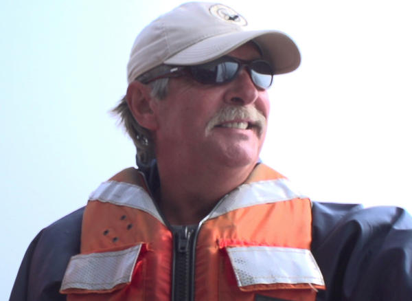 Joe Howlett, an expert in rescuing whales from tangled fishing gear, died on Monday. He's seen here off the coast of Canada's Campobello Island in 2015.