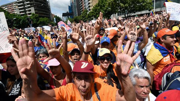 Opposition activists take part in a demonstration marking 100 days of protests against Venezuelan President Nicolas Maduro in Caracas on Sunday.