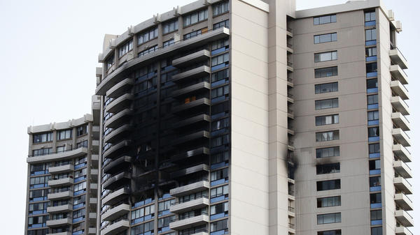 The exterior of the Marco Polo building in Honolulu is left charred after a fire broke out on Friday.