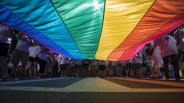 Marchers unfurl a rainbow flag at the Equality March for Unity and Pride in Washington, D.C., in June.