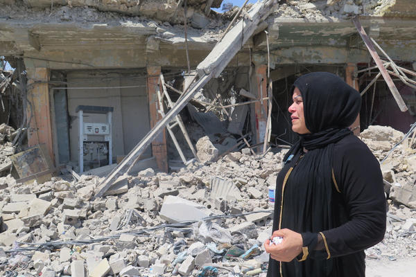 Manal Idrees, a former resident of west Mosul, returns to the Old City on a grim mission to try to find the body of her son. She says he was beheaded by ISIS because his uncles were police officers.