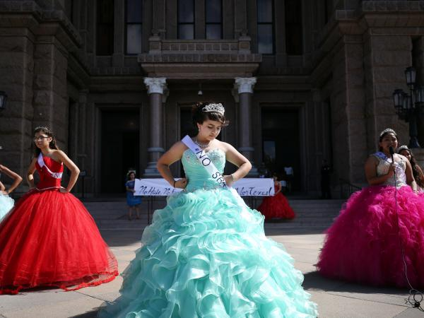 Jennifer Ramirez and 14 other young women wearing quinceañera dresses protested on the south steps of the Texas State Capitol in Austin on Wednesday. They protested SB4, an immigration enforcement law.