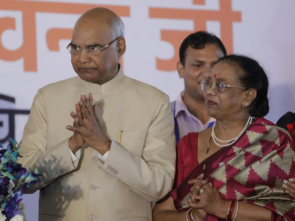 India's new President Ram Nath Kovind, accompanied by wife Kavita Kovind, receives greetings from well-wishers after being elected in New Delhi on Thursday. Kovind was elected to the largely ceremonial post by the Indian Parliament and state legislatures.