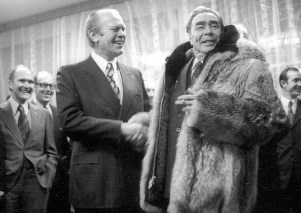 President Gerald Ford shakes hands with Soviet leader Leonid Brezhnev on Nov. 24, 1974, in a meeting in the Soviet city of Vladivostok. Several weeks later, Ford signed a law that would place restrictions on Soviet trade with the U.S. for nearly four decades.