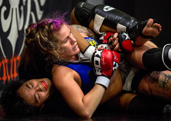 "Professional fighter Gina Mazany practices during a training session at Xtreme Couture Mixed Martial Arts in Las Vegas. She well remembers her first concussion — which came in her first fight. ""I was throwing up that night,"" Mazany says."