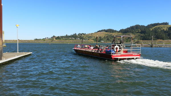 A Jerry's Rogue Jets boat with tourists on board leaves for a trip up the Rogue River in July.