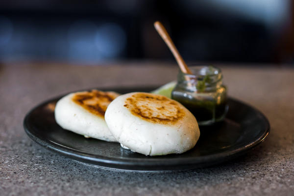 The Royal restaurant serves cheese arepas in Washington, D.C. As Venezuelans flee their troubled country, they bring with them a taste for the popular cornmeal cakes.